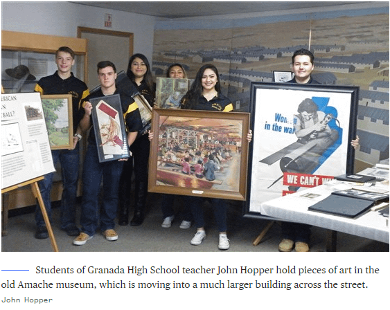Students of Granada High School teacher John Hopper hold pieces of art in the old Amache museum